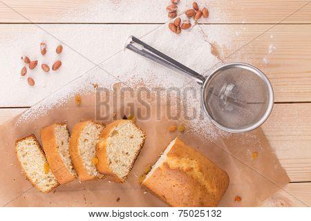 Sliced cake and sieve.