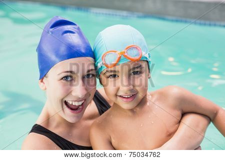 Happy mother and son in the swimming pool at the leisure center