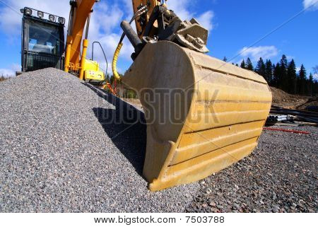 Excavator Against Blue Sky