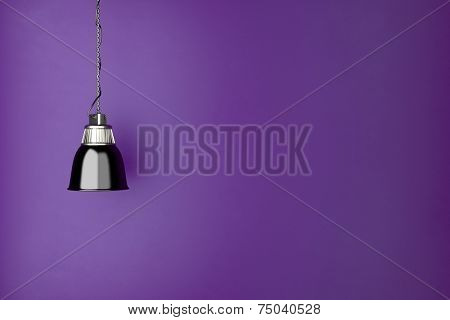 Lamp hanging in front of a purple wall in living room (3D Rendering)