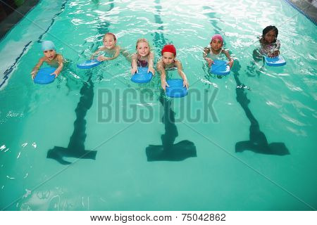 Cute little kids in the swimming pool at the leisure center