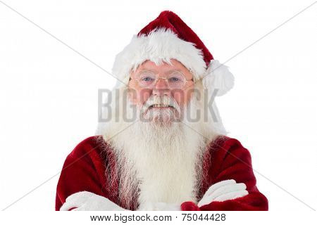 Santa smiles with folded arms on white background