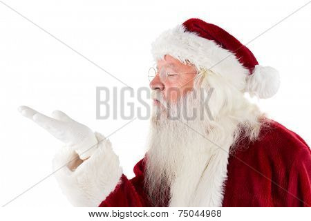 Santa Claus blows something away to the left side on white background