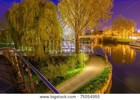 A Night in the Park. Late Spring Night in the Park. River and Park Alley. Horizontal Photography. Central Europe. France. Paris. Amiens.