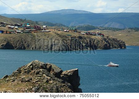 small speedboat near shore of Baikal lake