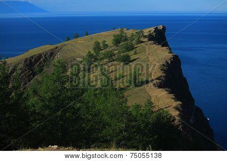 cape with many trees on the Baikal lake