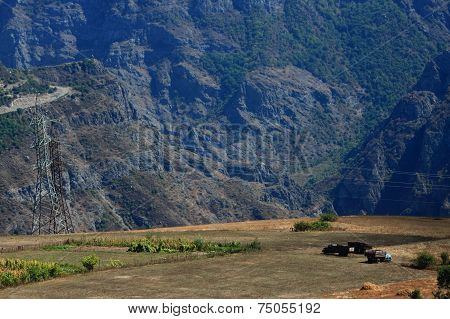 three trucks on the background of Caucasus mountains