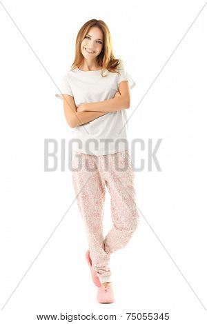 Beautiful young girl in pajamas isolated on white background