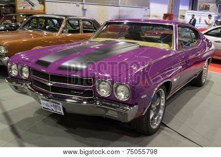VALENCIA, SPAIN - OCTOBER 17, 2014: A purple 1970 Chevrolet Chevelle 350 Malibu at the Retro Auto and Moto Valencia Classic Car Show.  The Chevelle was one of Chevrolet's most successful nameplates.