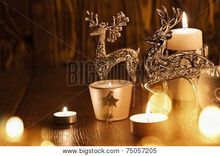 Christmas decoration with candles and deer