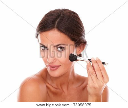 Beautiful Woman Applying Facial Care Product
