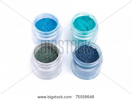 Mineral eye shadows in blue color, isolated on white background