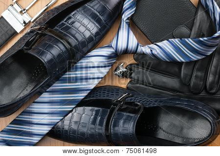 Classic Men's Shoes, Tie, Cufflinks, Gloves, Belt, Purse On The Wooden Floor
