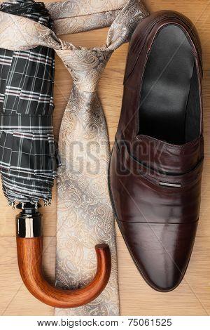 Classic Men's Shoes, Tie, Umbrella On The Wooden Floor