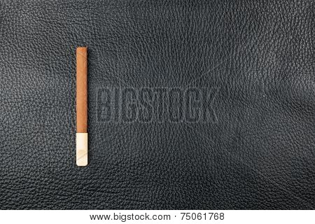 Cigar With A Wooden Mouthpiece Lies On Genuine Leather
