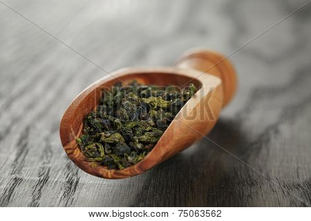 Oolong Green Tea In Wood Scoop