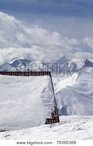 Roof Of Hotel In Snow And Ski Slope