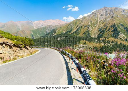 Road On Big Almaty Lake, Nature Green Mountains And Blue Sky In Almaty, Kazakhstan,asia At Summer