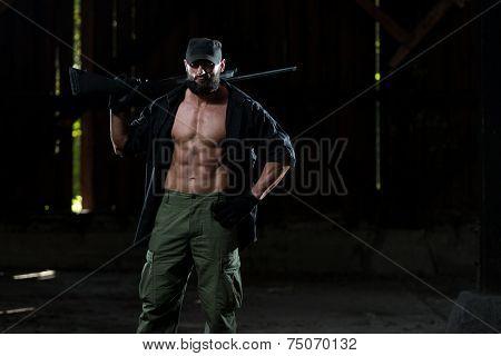 Beard Man With A Machine Gun
