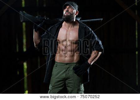 Fighter Holding Machine Gun