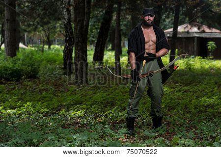 Caucasian Man Training With The Bow