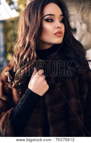 Portrait Of Sexy Beautiful Woman With Dark Hair In Luxurious Fur Coat