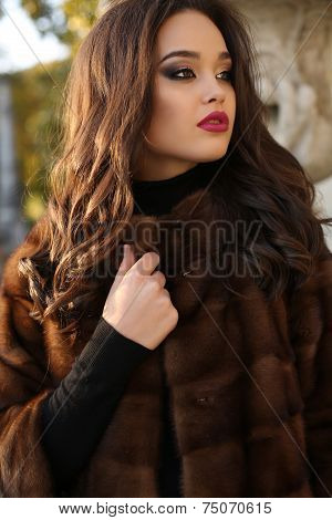 Portrait Of Sexy Beautiful Brunette Woman In Luxurious Fur Coat