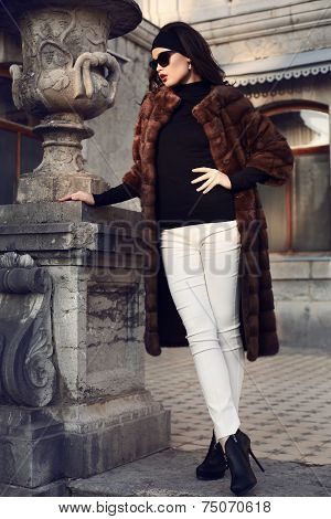 Beautiful Elegant Woman In Luxurious Fur Coat Posing In Castle