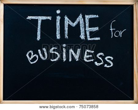 Time for business message handwritten with white chalk on wooden frame blackboard