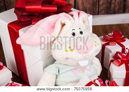 White Gift Boxes And Soft Toy On A Wood