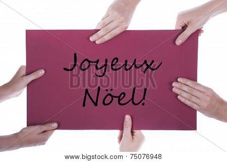 Hands Holding Sign Joyeux Noel