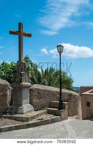Stone Cross And Lampost