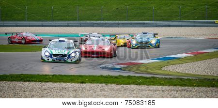 ASSEN, NETHERLANDS - OCTOBER 19, 2014: Competitors in the supercar challenge following eachother through a chicane on TT Circuit Assen