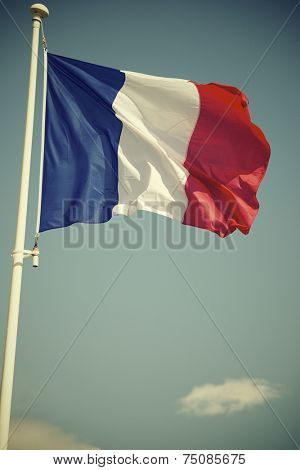 Close-up of the French national flag waving.