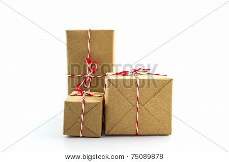 Cardboard Carton Wrapped With Brown Paper, Tied With String.