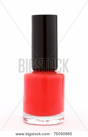 Bottle of red nail polish on white background
