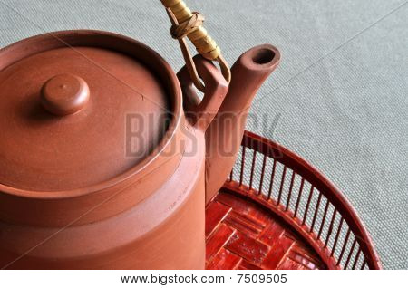 Clay teapot on bamboo basin