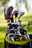 stock photo of caddy  - Dirty golf clubs - JPG