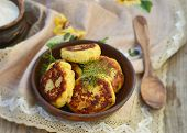 picture of patty-cake  - potato patties with fried bacon and onions - JPG