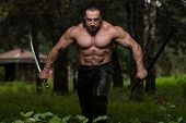 picture of heroes  - Action Hero Muscled Man Holding A Ancient Sword  - JPG