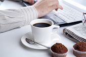 image of peppy  - businessman running and a cup of coffee on him desktop - JPG