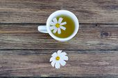 image of chamomile  - chamomile and chamomile tea on a wooden table