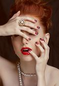 stock photo of ombre  - beauty stylish redhead woman with hairstyle and manicure wearing jewelry - JPG