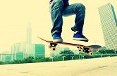 stock photo of skateboarding  - young woman skateboarder legs skateboarding at city - JPG