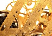 image of wind up clock  - Close up of a internal clock mechanism