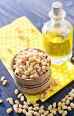 stock photo of pine nut  - pine nuts and pine nut oil in the bottle - JPG