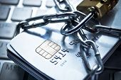 picture of malware  - chained credit cards security lock with password  - JPG