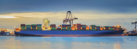 foto of shipyard  - Container Cargo freight ship with working crane loading bridge in shipyard at dusk for Logistic Import Export background - JPG