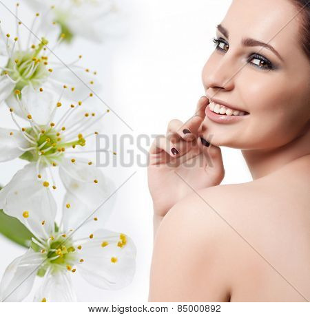 closeup portrait of attractive young caucasian smiling woman  isolated on white studio shot lips toothy smile face head and shoulders looking at camera eyes makeup hand nails tooth spring flowers