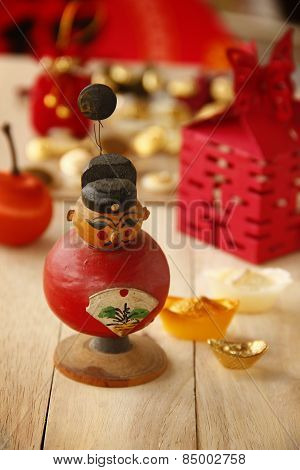 The Red Auspicious Chinese Doll